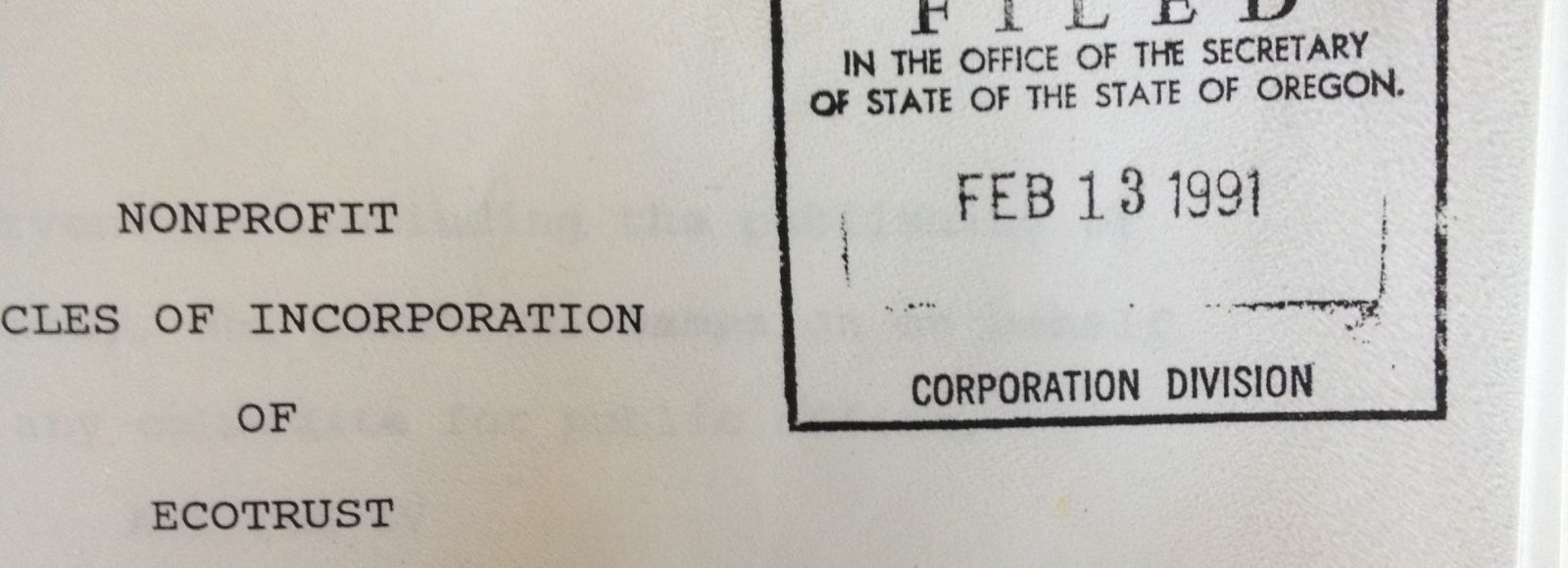 close up on paperwork declaring Ecotrust a non-profit