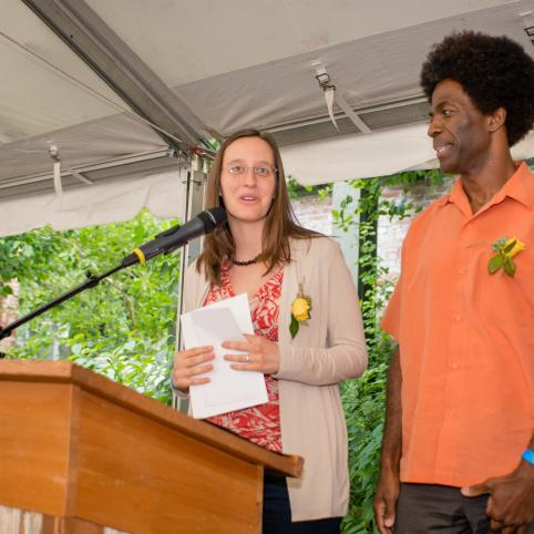 Representatives from Portland Fruit Tree Project accept a Local Hero Award on stage