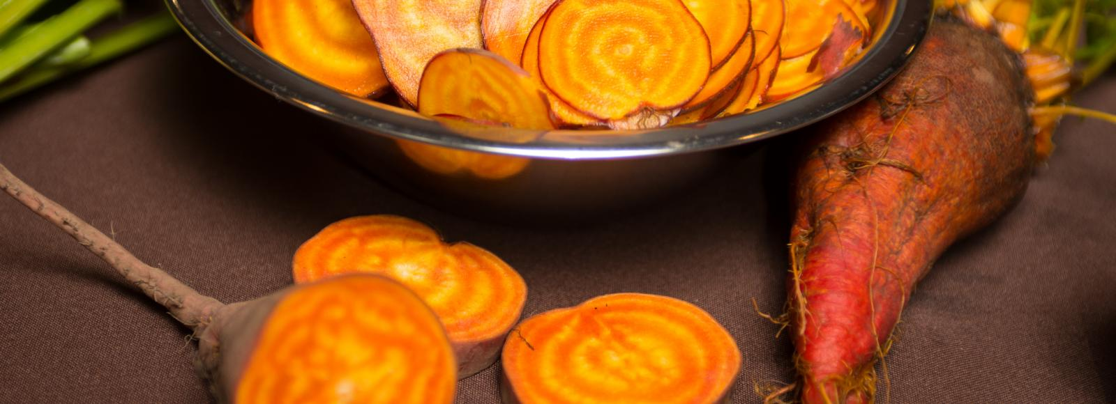 Beets bred for flavor, sliced into rounds showing their striated centers.