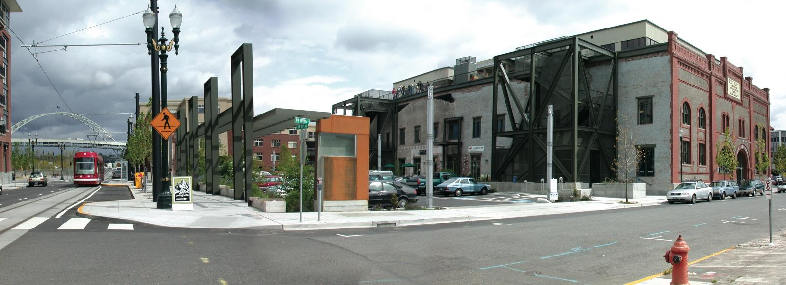 A view of the Natural Capital Center, shortly after the renovation was completed in 2001, from the southwest. You can see the Fremont Bridge to the north and the streetcar tracks that run along the west side of our block.