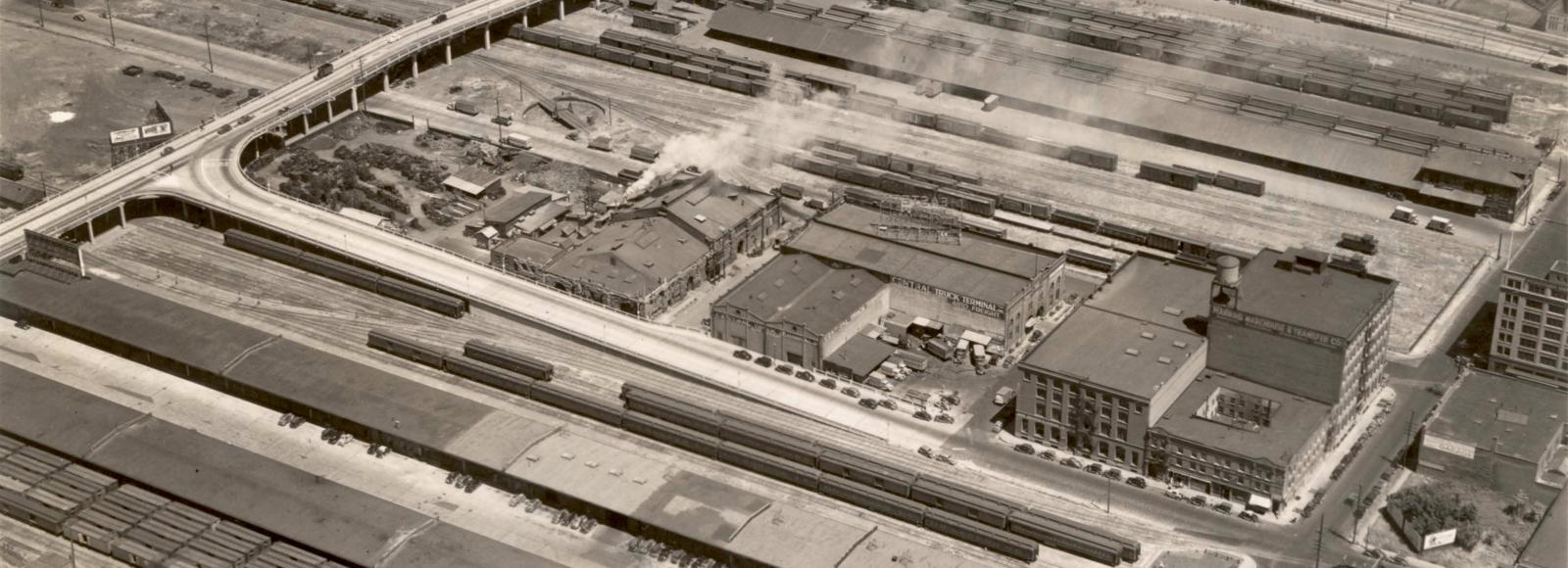 An aerial view of the Natural Capital Center c. the 1930s. At that time the building was completely surrounded by rail yards and transportation terminals.