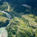 aerial view of a forested town with waterways, green, lush