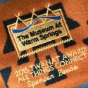 "wool Pendleton blanket with Native American pattern is embroidered with ""2015 TWANAT Award All Things Connect, Spencer Beebe"""