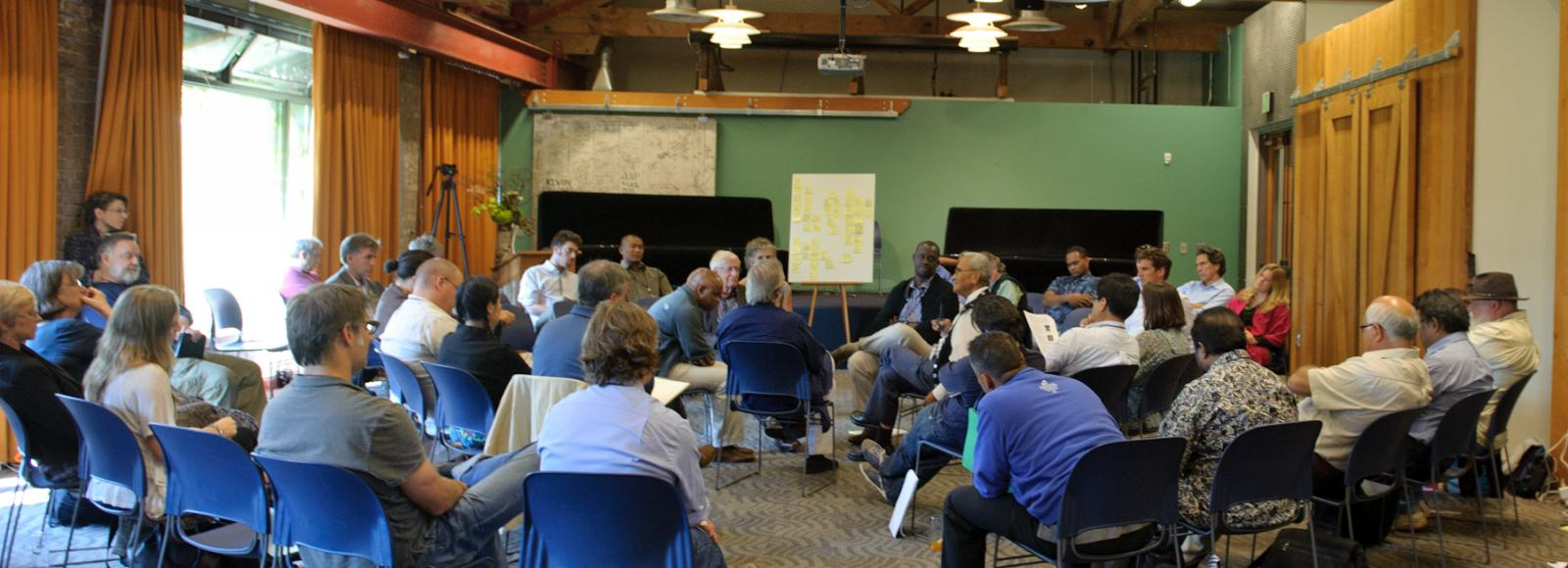 50+ people sitting in a conference, Ecotrust, Portland, BFJCC