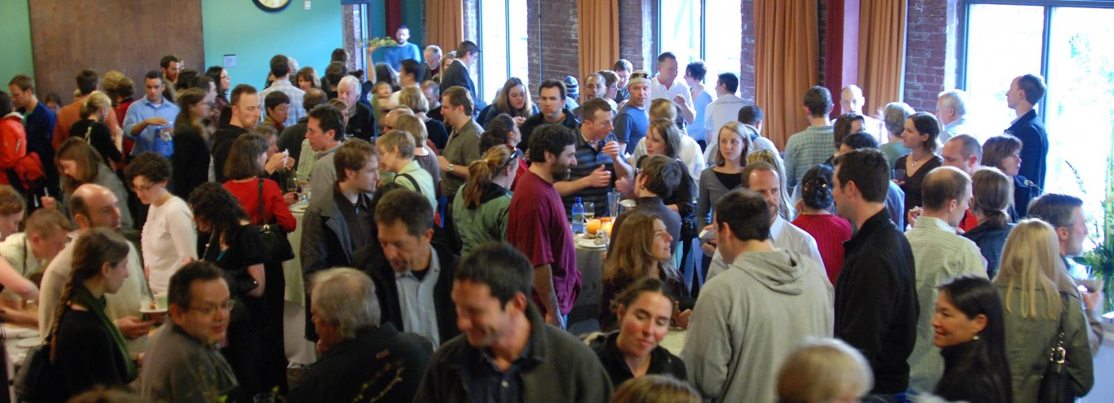 Crowd of people - 200 or so - inside the BFJCC, Natural Capital Center, Portland