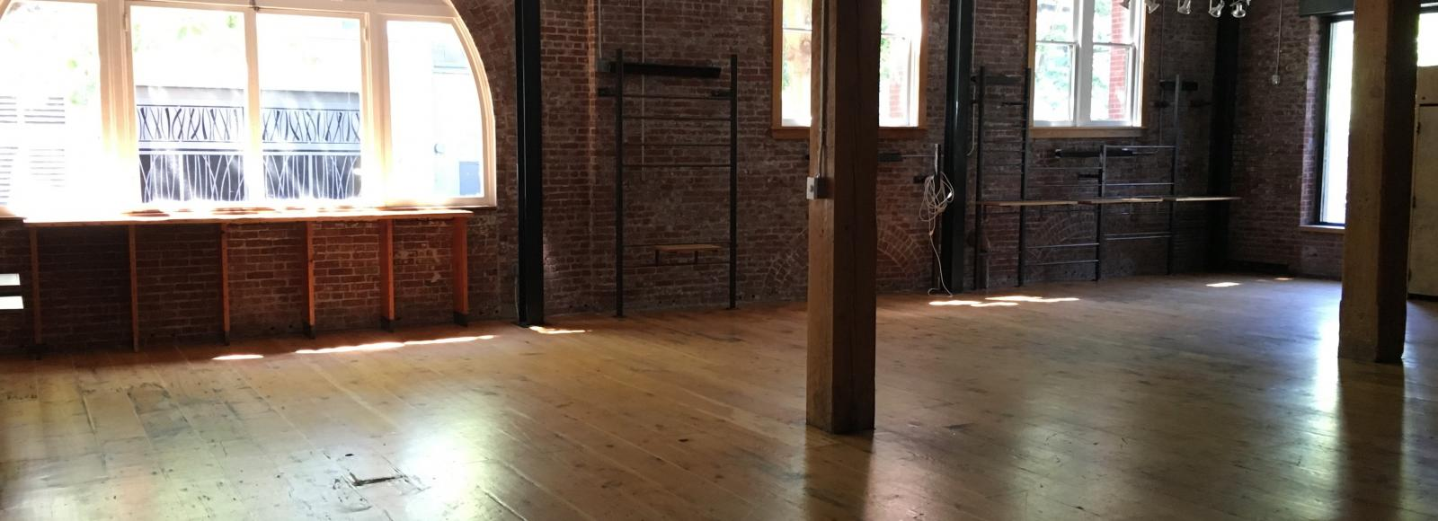 Empty venue with wood and brick