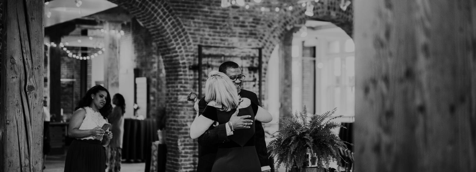 Black and white of two people hugging