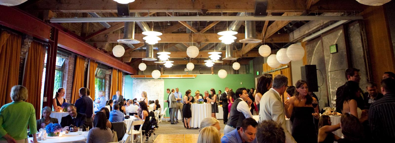 Party inside the Billy Frank Jr. conference center conference room. Dance floor. White paper lanterns. Lots of people shmoozing.