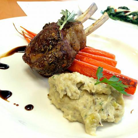 Third place entree: a pan roasted lamb chop leaned against roasted carrots on top of a portion of sunchoke puree.