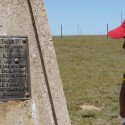 Mpumi reading a monument honoring his grandfather.