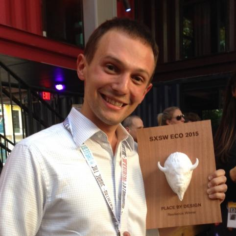 Ecotrust's Nathan Kadish holds white buffalo head award while smiling broadly