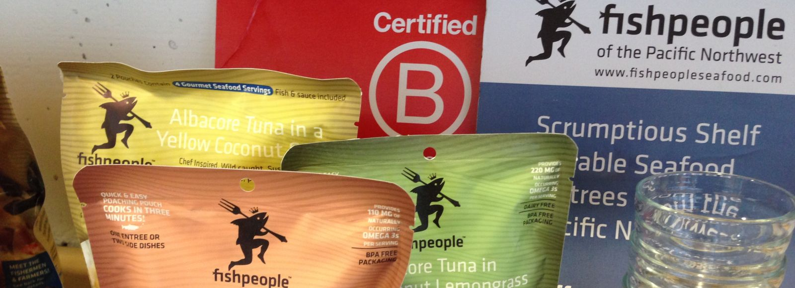 Colorful bags of fish on a table from Certified B Corp organization fishpeople