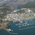 Aerial view of Ilwaco Washington port with little white boats in harbor