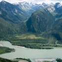 Steep mountains behind river