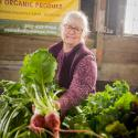 Suzanne Ballard from Dinihanian's Farm and Market holding a bunch of beets.