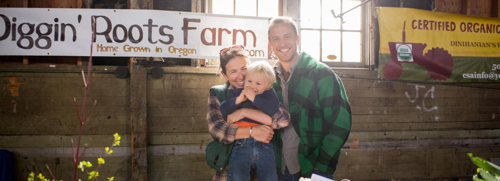 Conner Dell, Sarah Rose, and their son Wendell of Diggin' Roots Farm.