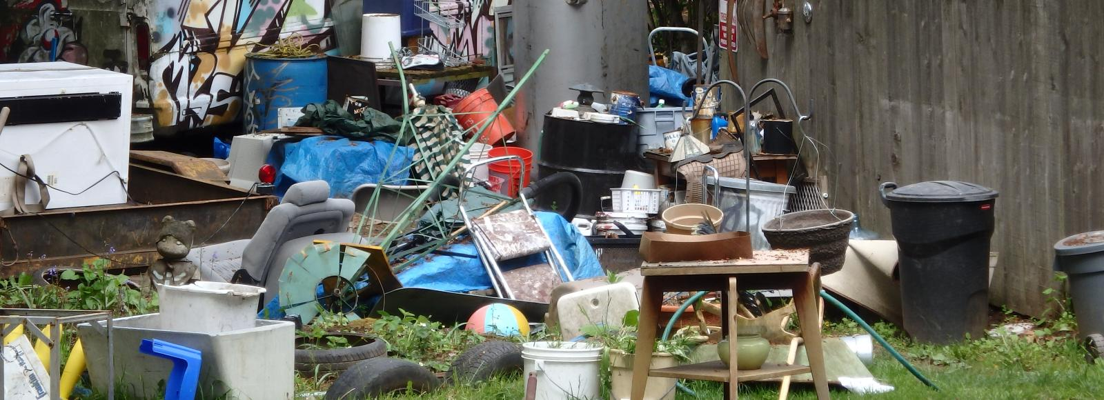 A backyard trash pile in the Cully Neighborhood.