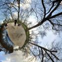 Small circular image of park and people.