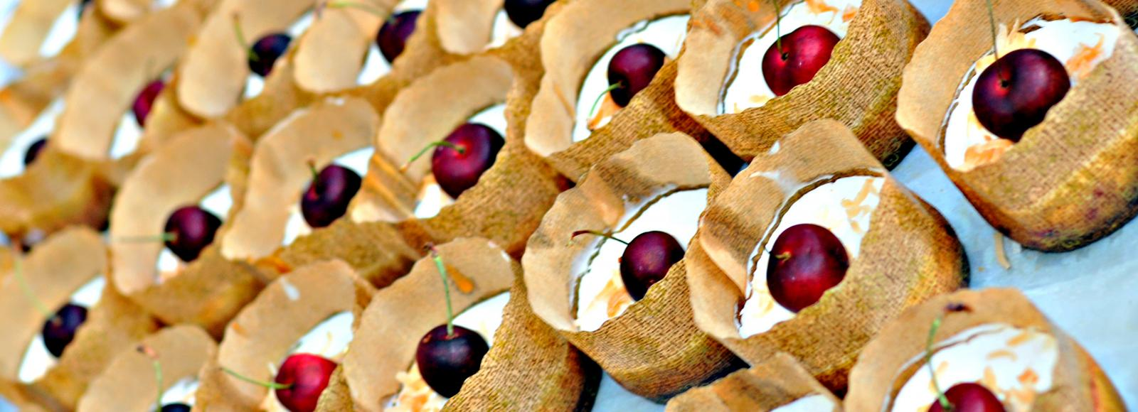 Cherry tarts wait to be served to guests at an event