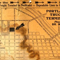 """old, stained piece of paper that advertises the """"Portland Truck Terminal"""". From the 1930's."""