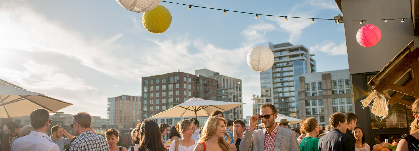 On a bright sunny day, the Ecotrust rooftop terrace is abuzz with people, sipping drinks and talking. Paper lanterns swing from a string of bulb lights.
