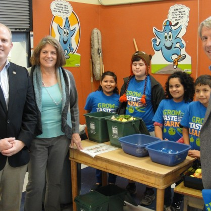 From left: Representative Brian Clem (D-Salem, District 21), Representative Representative Vicki Berger (R-Salem, District 20) and Congressman Kurt Schrader (D, District 5) check out the composting setup in the cafeteria at Grant Community School in the Salem-Keizer School District.