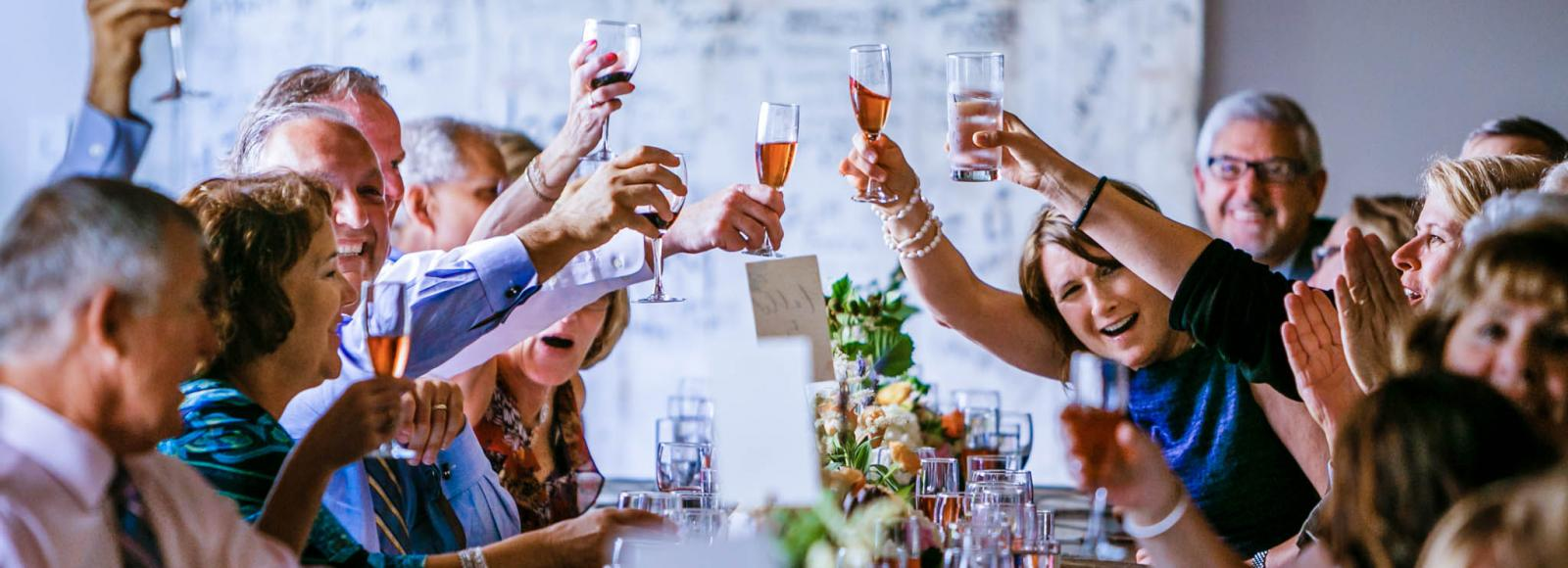 friends and family cheers to newlyweds