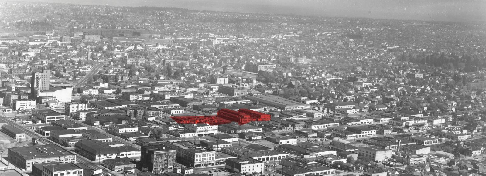 Aerial view of the central east side in black and white with the Redd campus highlighted in red.