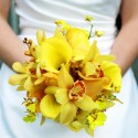 Bride holding yellow flowers
