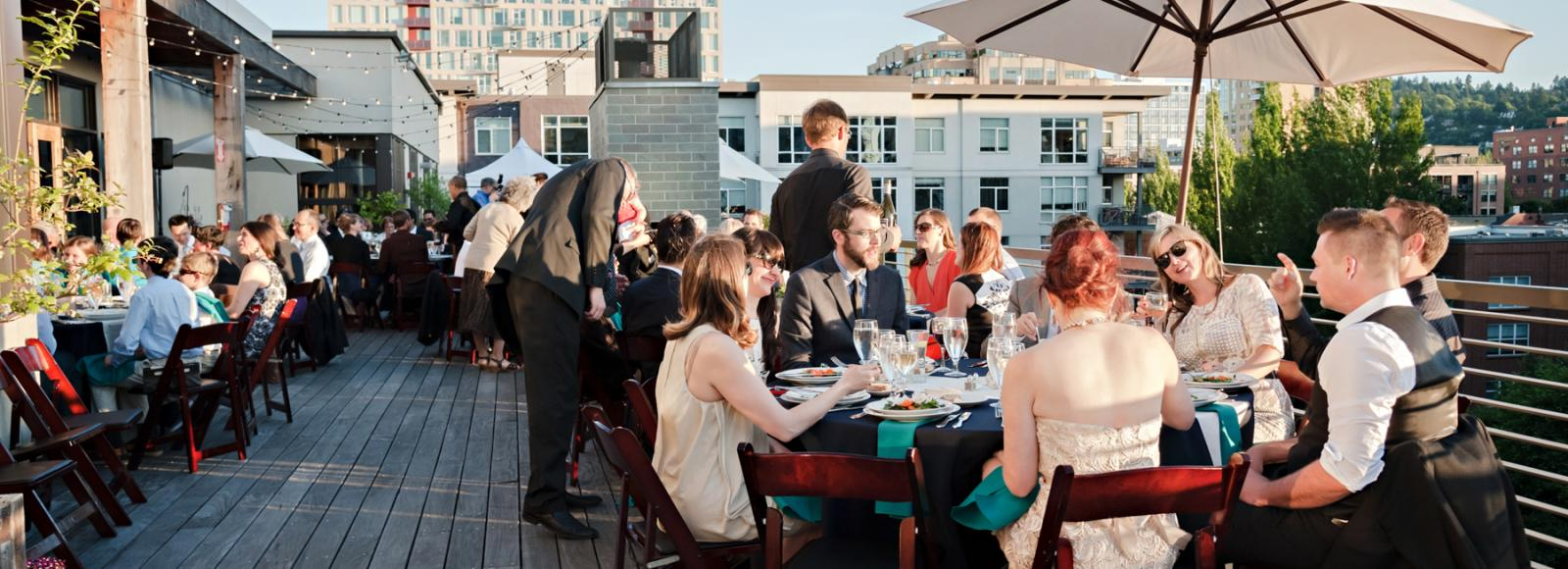 Guests dining on the roof for a wedding reception