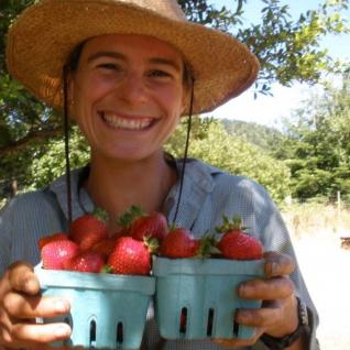 Women holding two pints of strawberries.