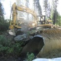 Backhoe working on river restoration.