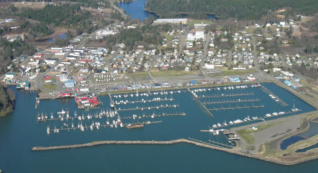 an aerial view of a town located along the coast