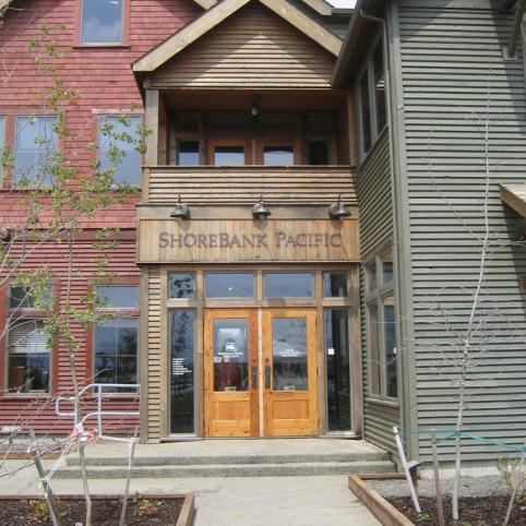 the outside of a new building with ShoreBank Pacific title over the doors
