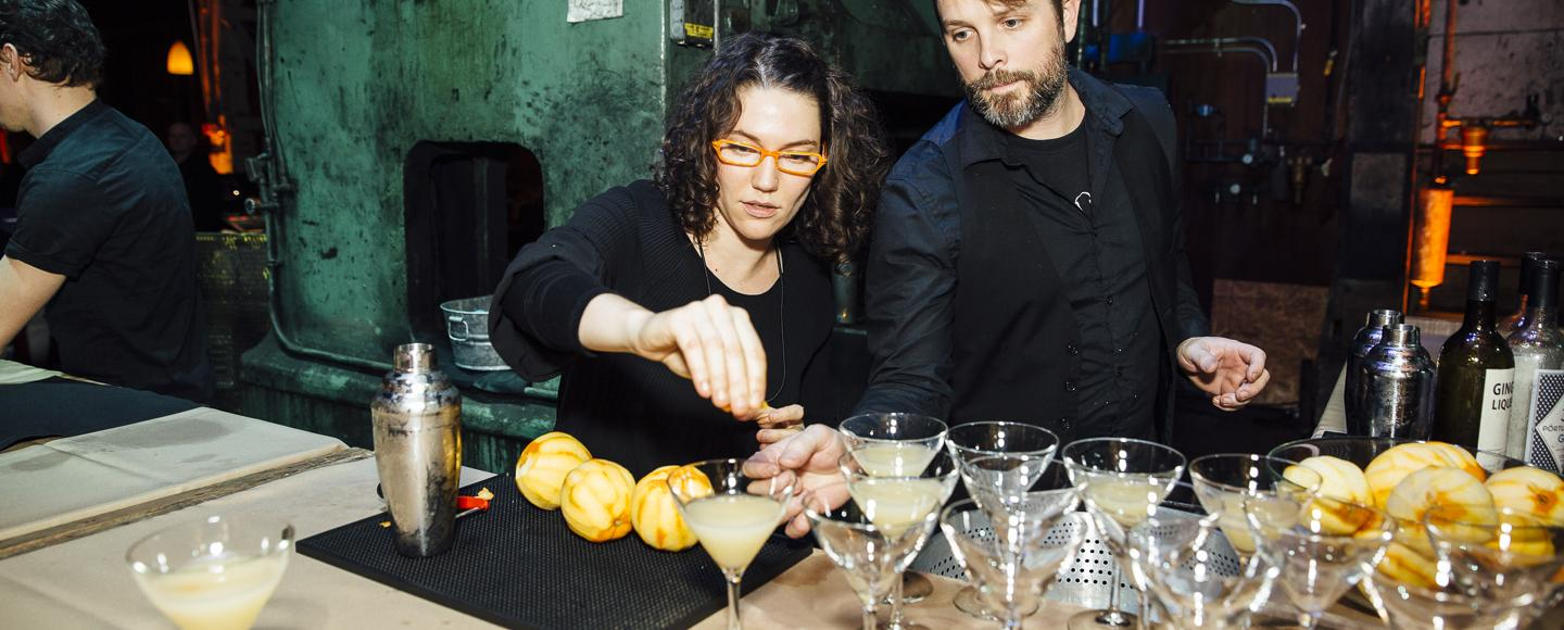 Mixologists prepare cocktails in with lemon.