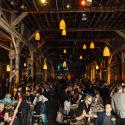 A 100 year old warehouse lit by amber lanterns was filled with more than 300 attendees for Ecotrust's Gala