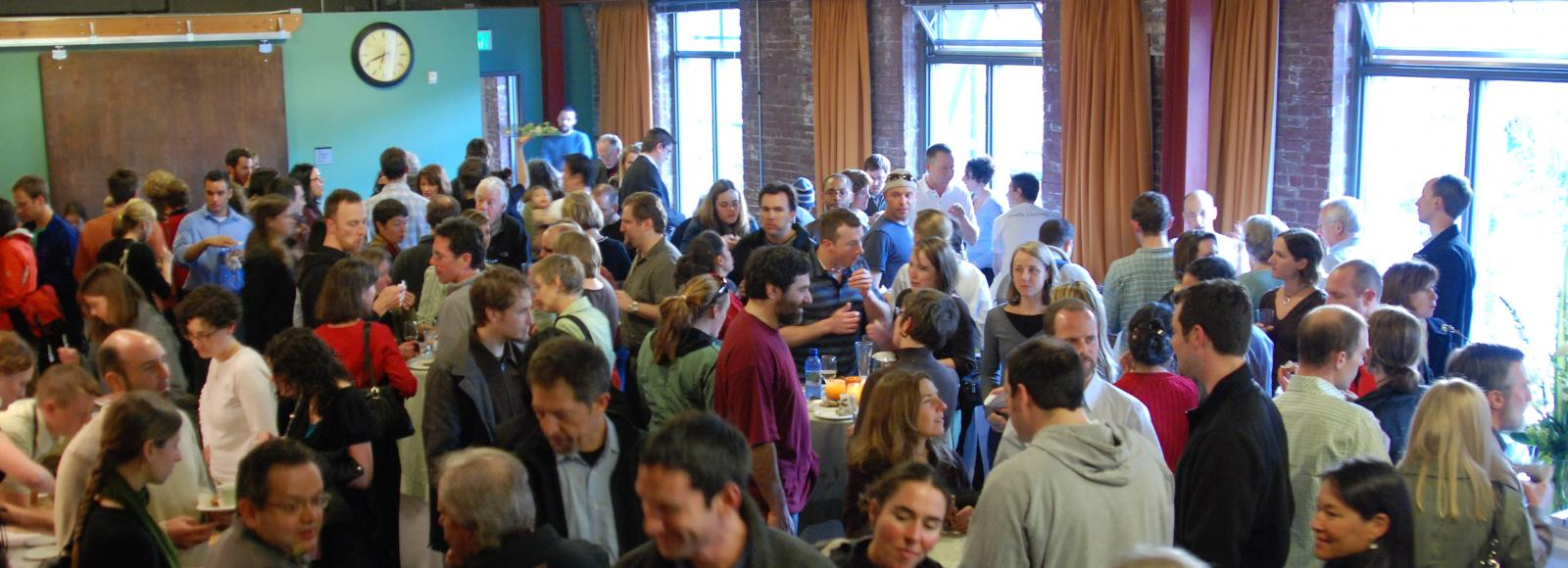 Crowd of people - 200 or so - inside the conference room at the Natural Capital Center, Portland