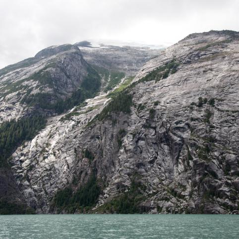 A granite slope shoots up from the milky blue waters of Gardner Canal in the Kitlope.