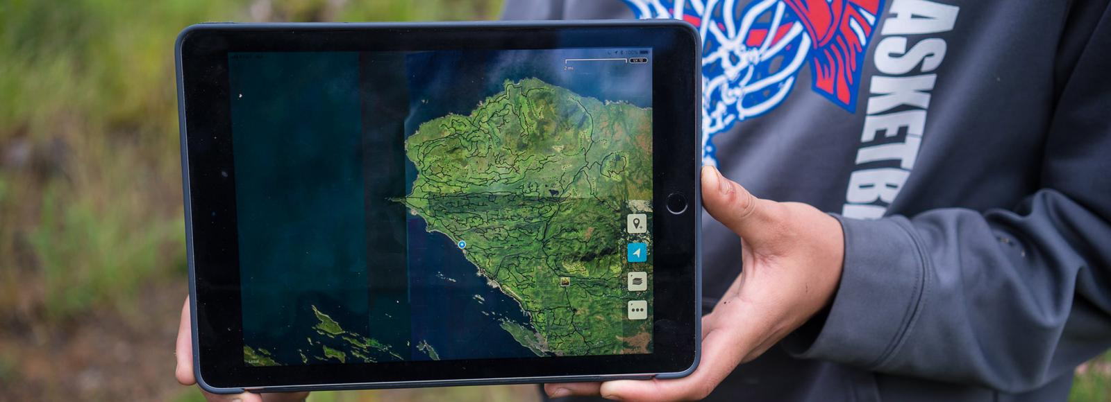 A tablet with a map on the screen.