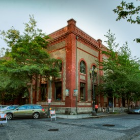 Corner view of the Ecotrust Natural Capital Center building, a renovated warehouse, NW 9th and Irving, Portland Oregon, late afternoon light