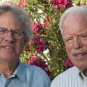 Jack Vaughn and Ecotrust founder, Spencer Beebe standing in front of flowers