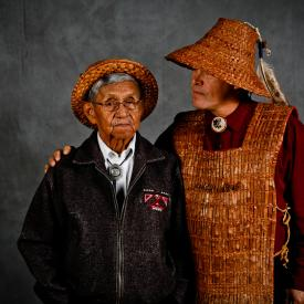 Brian Cladoosby of the Swinomish tribe stands with his arm around his father