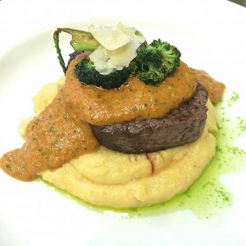first place entree: a seared tenderloin on creamy polenta with ramesco sauce, parsley oil, and charred broccoli