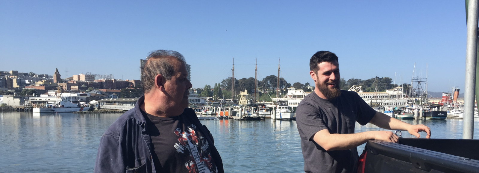 two men stand near bay