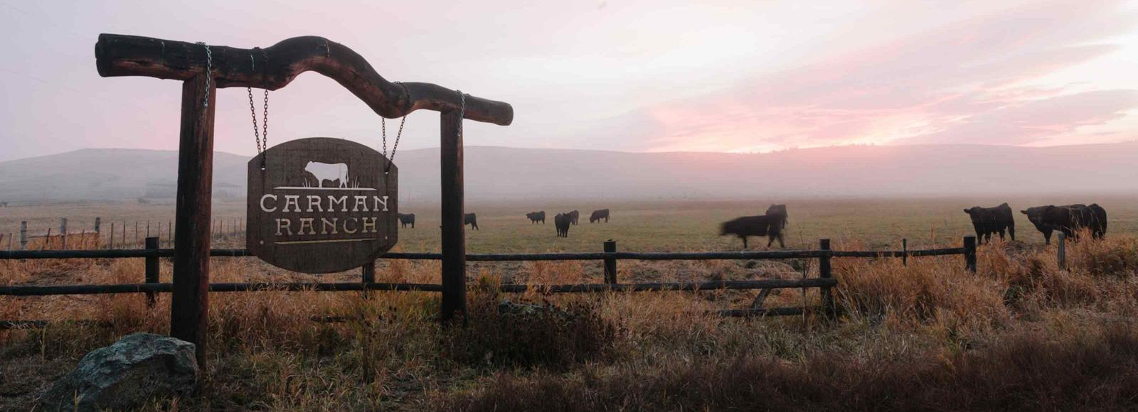 rural ranch at sunset, sign reads