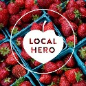 local hero award heart on bright red strawberries